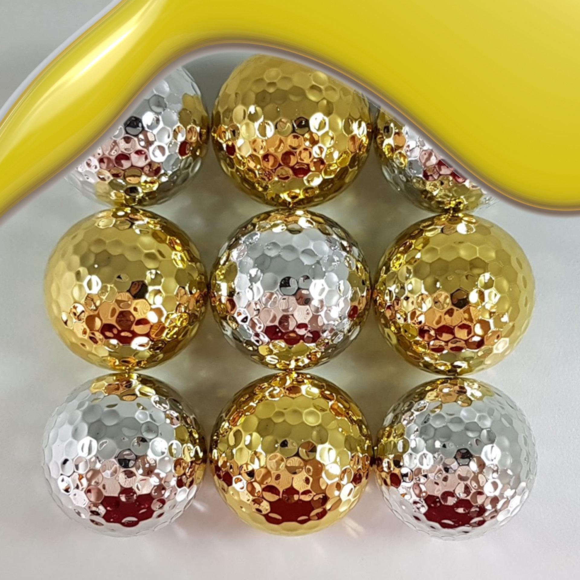 Golfbälle mit Gold/Silber bedampft